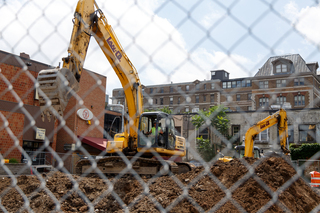 Construction workers excavate the ground on the former site of some popular Syracuse University student hangouts. Photo taken July 18, 2017